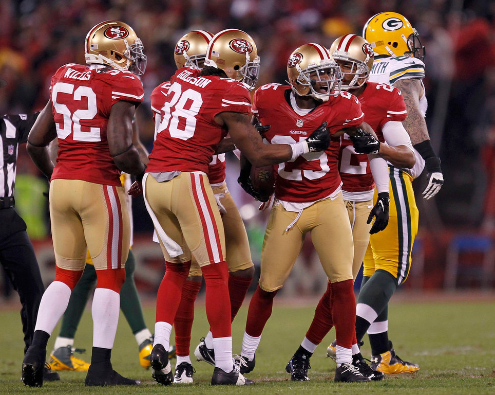 . San Francisco 49ers Tarrell Brown (2nd R) celebrates with teammates Carlos Rogers (R), Patrick Willis (L) and Dashon Goldson (2nd L) after intercepting a pass against the Green Bay Packers in the second quarter during their NFL NFC Divisional playoff football game in San Francisco, California, January 12, 2013.   REUTERS/Robert Galbraith