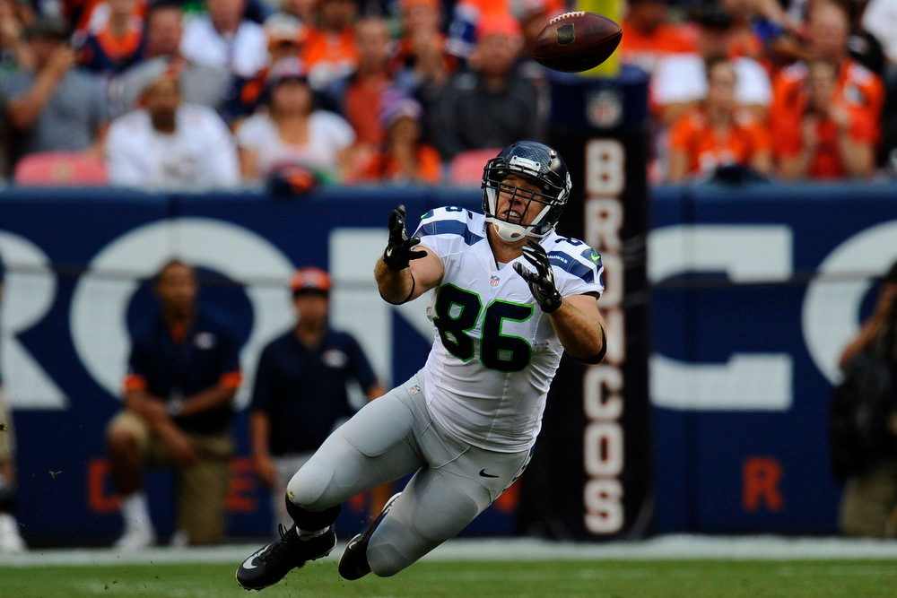 . Zach Miller (86) of the Seattle Seahawks comes up short on a pass during a preseason game between the Denver Broncos and the Seattle Seahawks at Sports Authority Field at Mile High on Thursday, August 07, 2014 in Denver, Colorado.  (Photo by Kent Nishimura/The Denver Post)