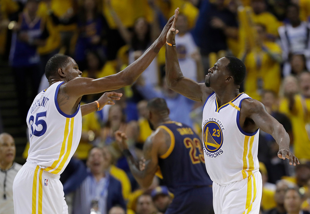 . Golden State Warriors forward Kevin Durant (35) and forward Draymond Green (23) celebrate during the second half of Game 1 of basketball\'s NBA Finals against the Cleveland Cavaliers in Oakland, Calif., Thursday, June 1, 2017. (AP Photo/Marcio Jose Sanchez)