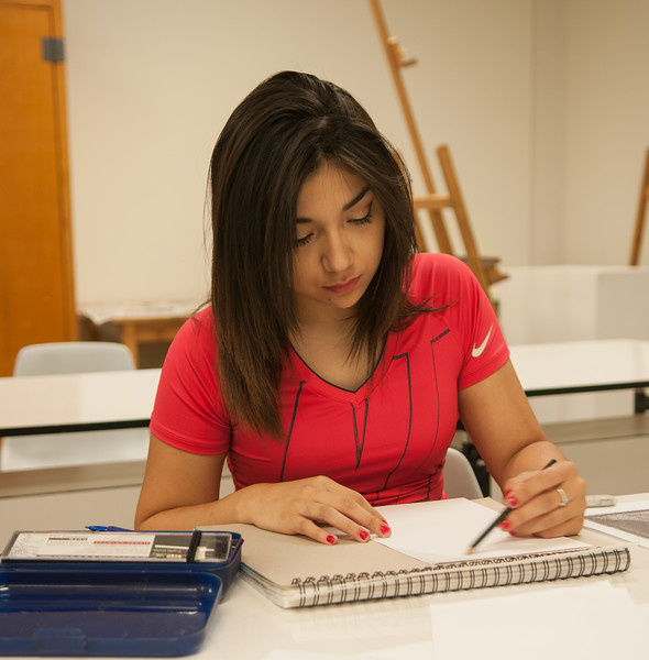 Amanda Garcia working on a sketch for her Design I course in the Center for Arts.