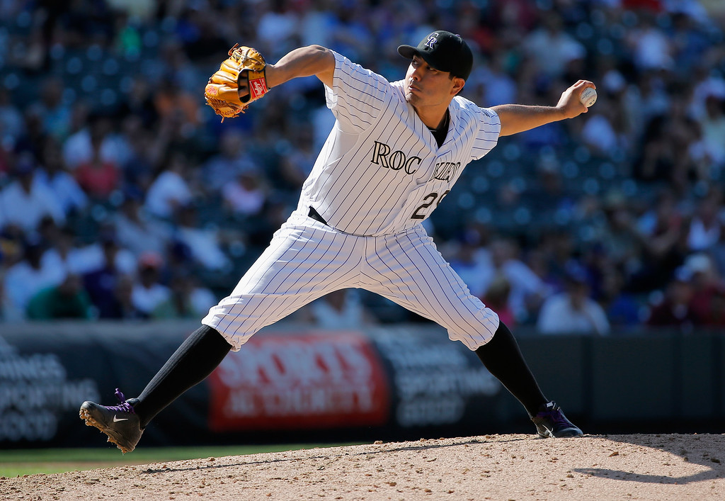 . DENVER, CO - SEPTEMBER 17:  Starting pitcher Jorge De La Rosa #29 of the Colorado Rockies delivers against the Los Angeles Dodgers at Coors Field on September 17, 2014 in Denver, Colorado. De La Rosa earned the win as the Rockies defeated the Dodgers 16-2.  (Photo by Doug Pensinger/Getty Images)