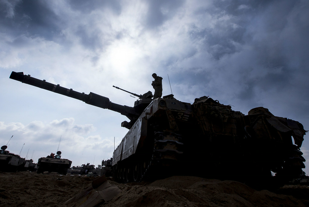 . An Israeli soldier prepares a Merkava tank at an army deployment along the border between Israel and the Hamas-controlled Palestinian territory on July 29, 2014.  AFP PHOTO / JACK  GUEZ/AFP/Getty Images