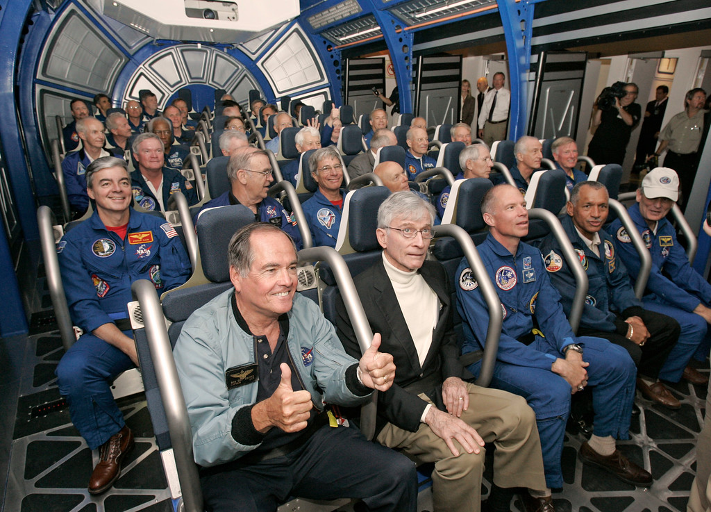 . Nearly 40 former astronauts, including front row from left, Bob Crippen, John Young, Rick Searfoss, Charles Bolden, and Norm Thagard prepare to take a ride on the new Space Shuttle Experience launch simulator during grand opening ceremonies at the Kennedy Space Center Visitor Complex in Cape Canaveral, Fla., Friday, May 25, 2007.    (AP Photo/John Raoux)