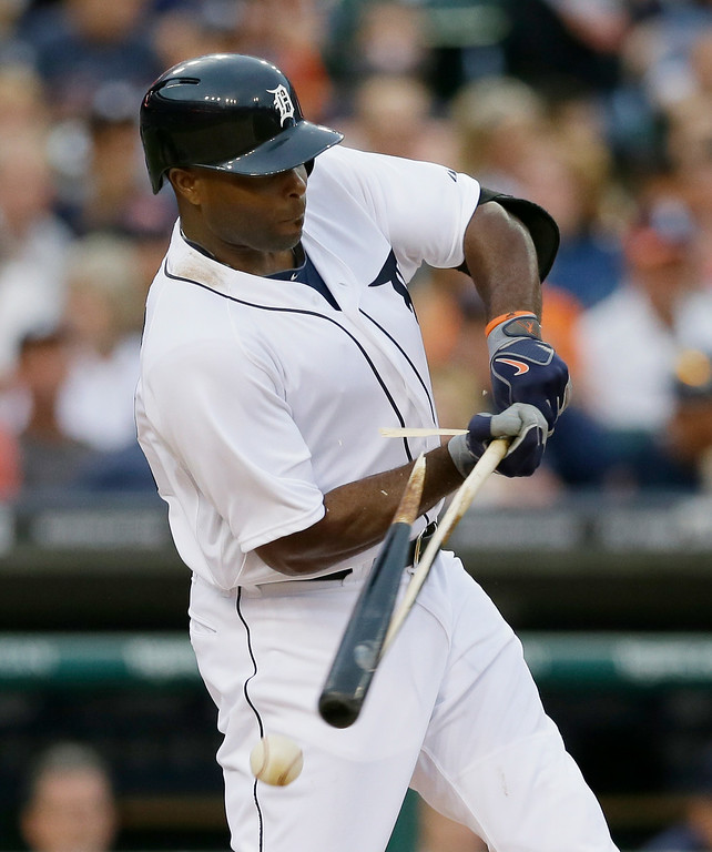 . Detroit Tigers\' Torii Hunter breaks his bat during the fourth inning of a baseball game against the Cleveland Indians in Detroit, Friday, July 18, 2014. (AP Photo/Carlos Osorio)