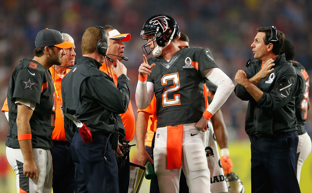 . GLENDALE, AZ - JANUARY 25: Team Irvin quarterback Matt Ryan #2 of the Atlanta Falcons talks with the Team Irvin coaching staff during the second half of the 2015 Pro Bowl at University of Phoenix Stadium on January 25, 2015 in Glendale, Arizona.  (Photo by Christian Petersen/Getty Images)