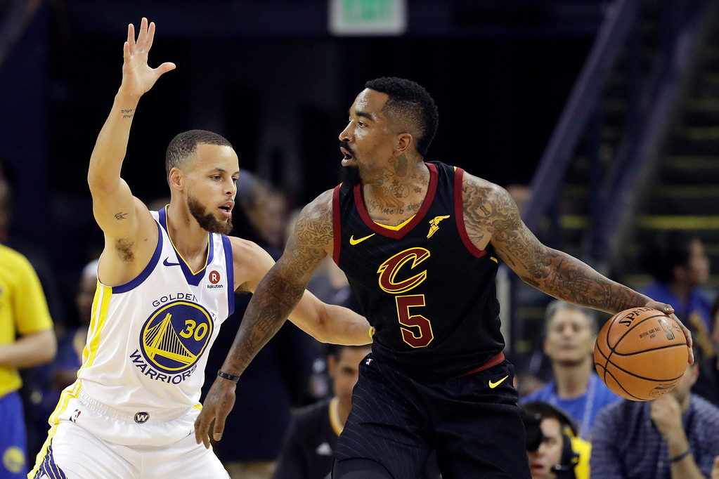 . Cleveland Cavaliers guard J.R. Smith (5) is defended by Golden State Warriors guard Stephen Curry (30) during the first half of Game 1 of basketball\'s NBA Finals in Oakland, Calif., Thursday, May 31, 2018. (AP Photo/Marcio Jose Sanchez)