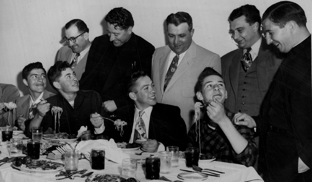 . MAY 23 1950,  J. K. Mullen Home for Boys Forty students, the entire student body of Fort Logan\'s J.K. Mullen high school, were guests at a spaghetti dinner Tuesday night at Goetano\'s restaurant, 3760 Tejon street. The youths were the guests of Anthony, Eugene and Clyde Smaldone. Other guests at the banquet included the Rev. Jim Moynihan, assistant pastor of Annunciation Catholic church; the Rev. Tom LoCasio of Mount Carmel Catholic pariah, and City Councilman Ernest Marranzino. A few of the students are (left to right) Phil Quintana, Bert Olivas, Johnny Maes and Ronald Wynne. Standing are Eugene Smaldone, Father Jim Moynihan, Clyde Smaldone, Marranzino and Father LoCasio.  Credit: The Denver Post