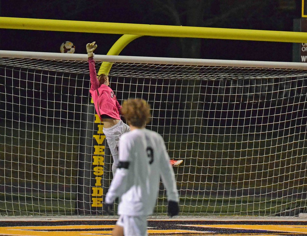 . Paul DiCicco - The News-Herald University goalkeeper Michael Zemanek lunges for a shot over the bar Oct. 28.