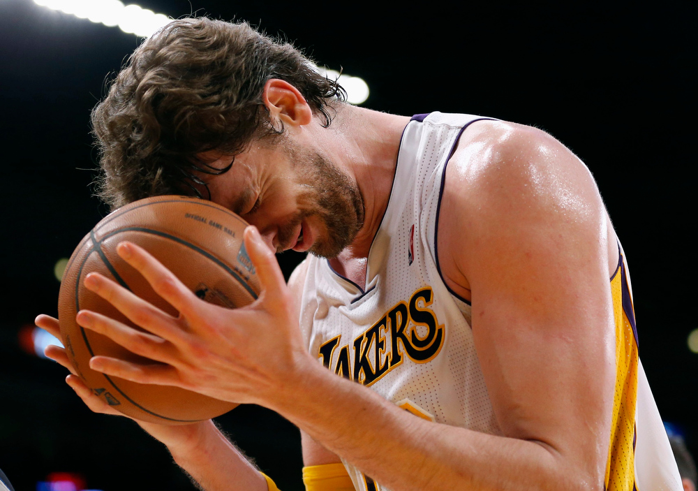 . Los Angeles Lakers\' Pau Gasol of Spain reacts after he is called for a foul on Denver Nuggets\' Ty Lawson during the first half of their NBA basketball game in Los Angeles January 6, 2013. REUTERS/Danny Moloshok