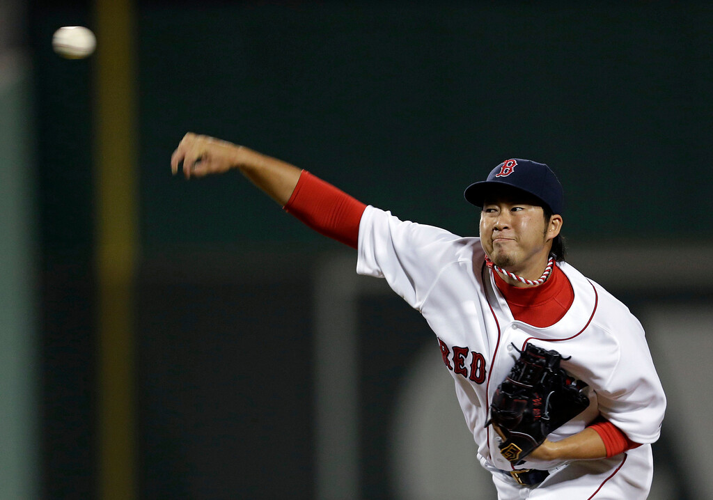 . Boston Red Sox relief pitcher Junichi Tazawa pitches in the seventh inning of an exhibition baseball game against the Minnesota Twins. (AP Photo/Gerald Herbert)