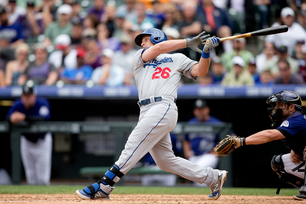 . DENVER, CO - JUNE 7:  Tim Federowicz #26 of the Los Angeles Dodgers hits a three-run home run during the seventh inning against the Colorado Rockies at Coors Field on June 7, 2014 in Denver, Colorado. The Rockies defeated the Dodgers 5-4 in 10 innings to end their eight game losing streak. (Photo by Justin Edmonds/Getty Images)