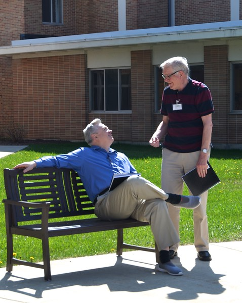 Fr. Ziggy and Fr. Jan relax before lunch.