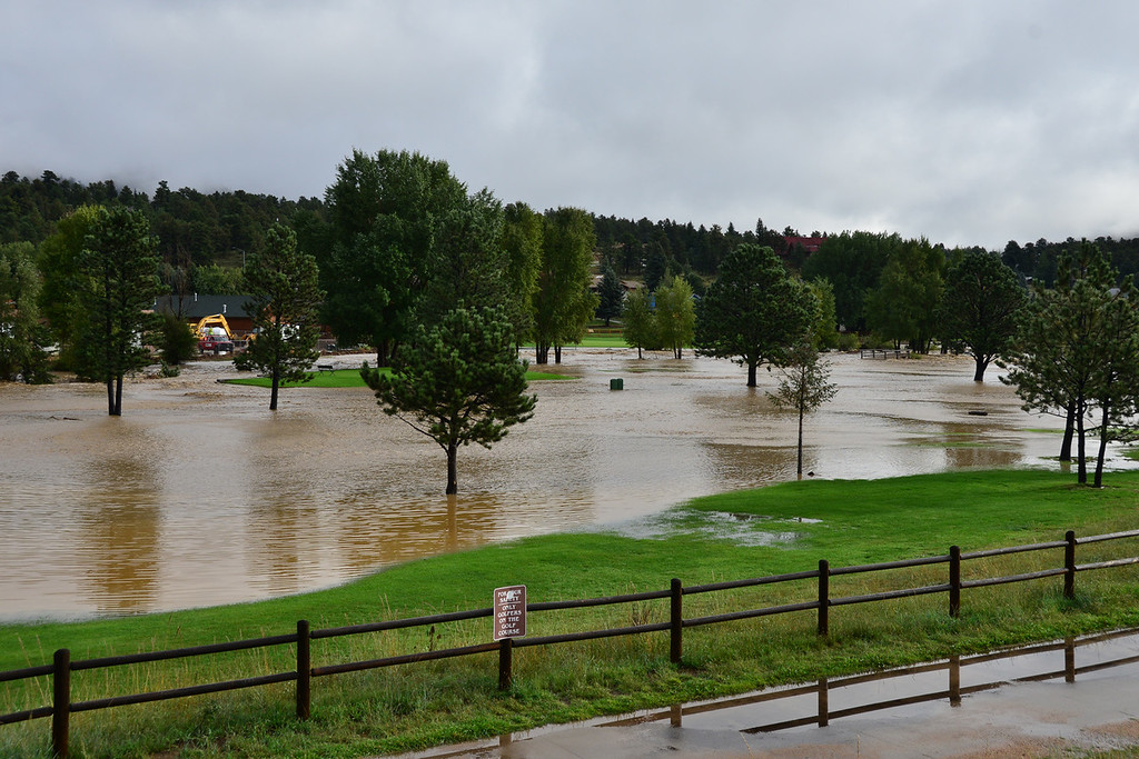 . Floodwater from the Big Thompson River cover the 9-hole golf course in Estes Park Friday morning, Sept. 13, 2013. John Cordsen/Estes Park Trail-Gazette
