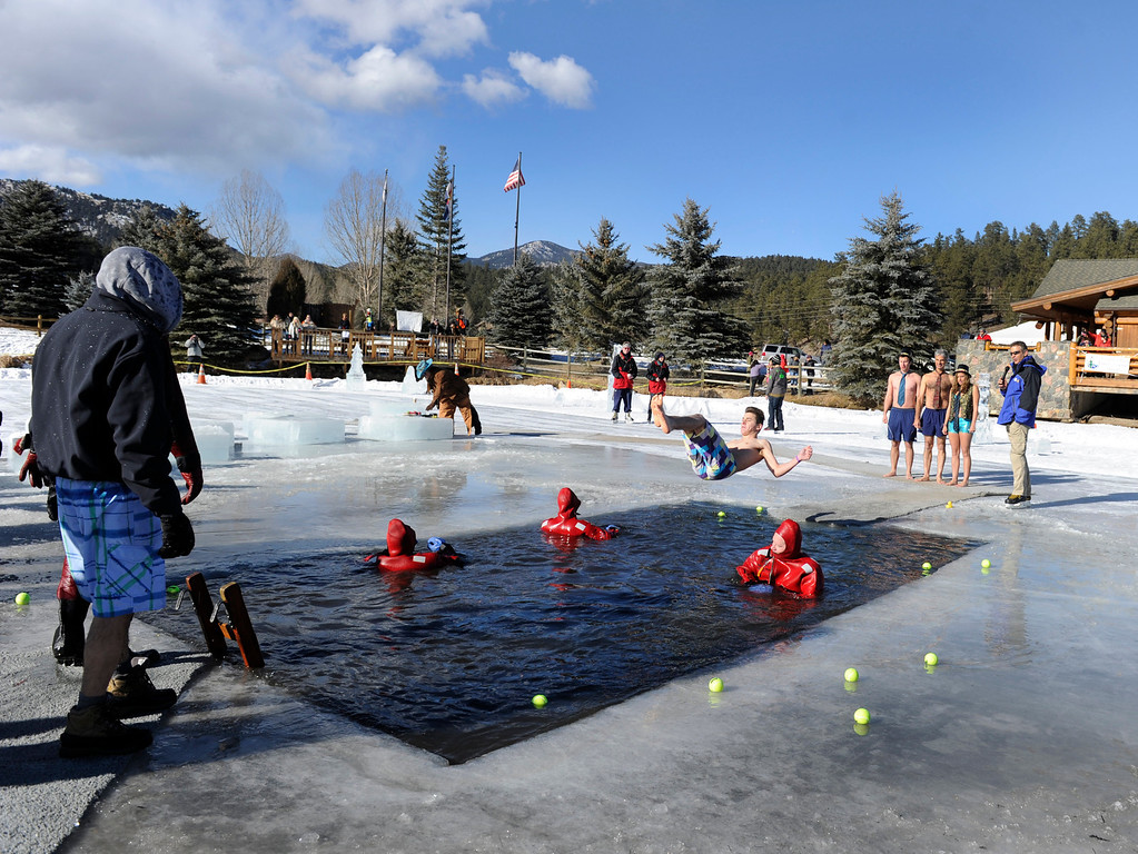 . Dozens joined in for the 6th annual Evergreen Lake Plunge on New Years Day, 2013, where only the very brave jumped, dove, and even performed a belly flop into the icy waters of Evergreen Lake. Kathryn Scott Osler, The Denver Post