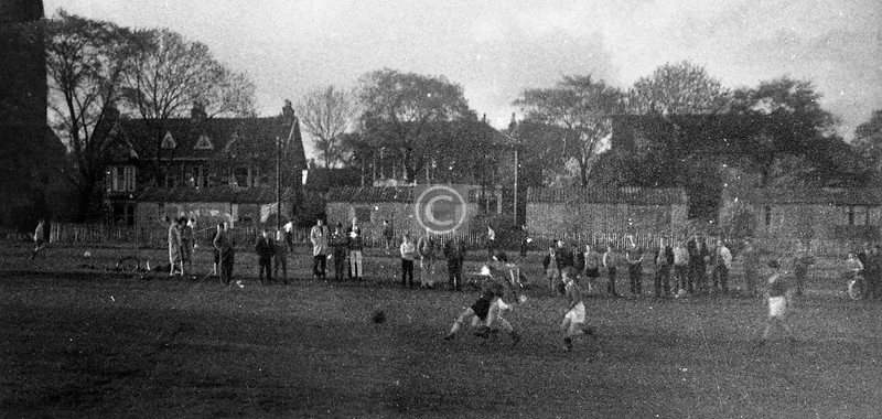 This image is of such dismal quality that I hesitate to post it even here, but it does show some of the prefabs which used to line the south side of this part of Queen's Drive, so has some interest. Of interest too perhaps is the number of spectators watching an age 11-14 BB football match; I think some Scottish League clubs today might be envious.   c1963