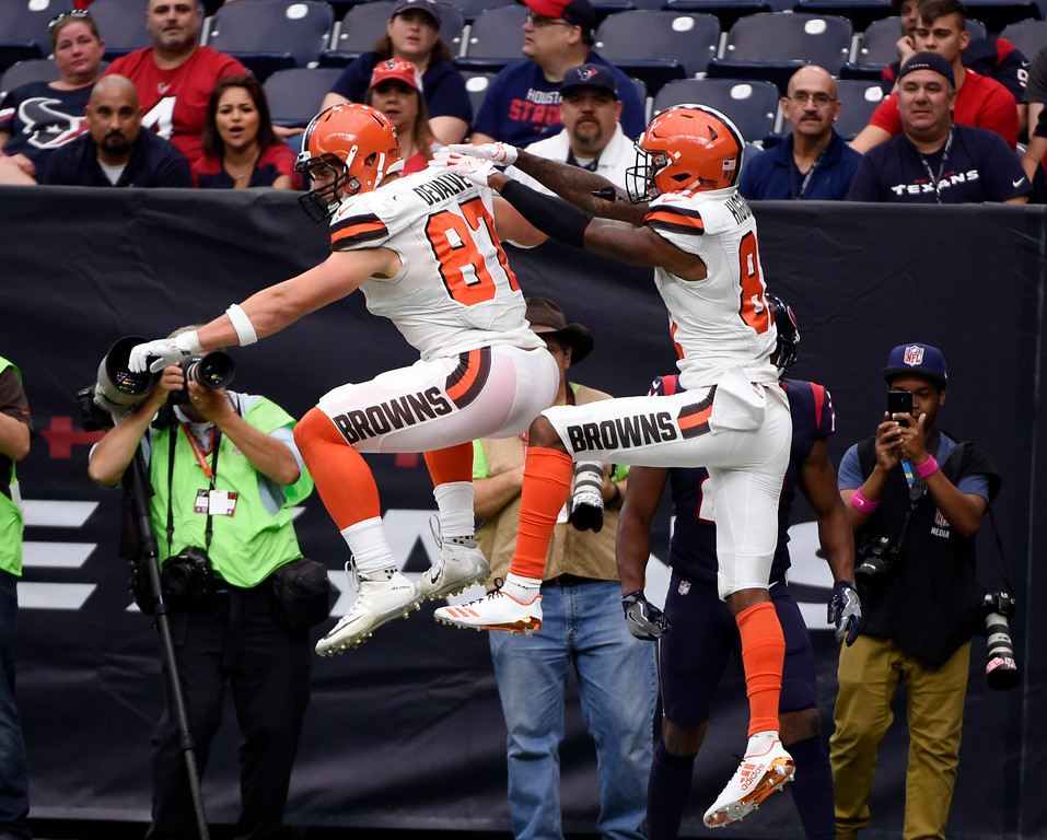 . Cleveland Browns tight end Seth DeValve (87) and wide receiver Rashard Higgins, right, celebrate a touchdown catch made by DeValve in the second half of an NFL football game against the Houston Texans on Sunday, Oct. 15, 2017, in Houston. (AP Photo/Eric Christian Smith)