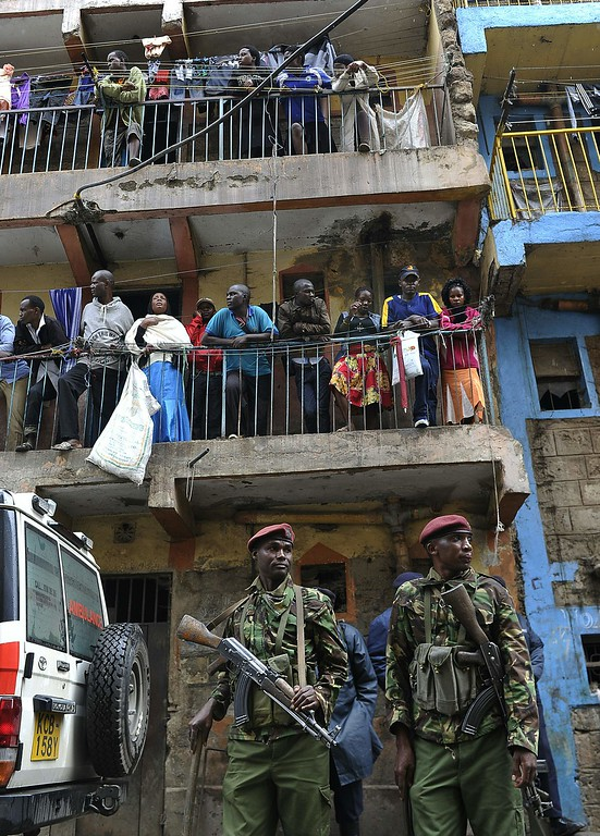 . Kenyan security forces stand guard as residents observe the rescue efforts of a building collapse in Nairobi on April 30, 2016. / AFP PHOTO / SIMON MAINA/AFP/Getty Images