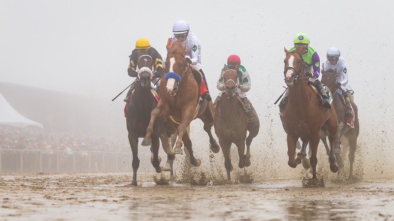 Justify leaps over the tram path, first time under the wire, in the Preakness Stakes.
