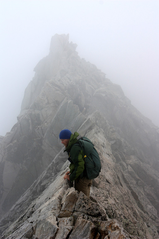 . Junaid Dawud begins the technical ridge approaching Capitol Peak in the Elk Mountain Range in late August. Dawud and friend Luke DeMuth have hiked 1,300 miles and climbed 57 of the state\'s 58 14,000-foot peaks and plan to finish their 70-day mission Sunday on Longs Peak.