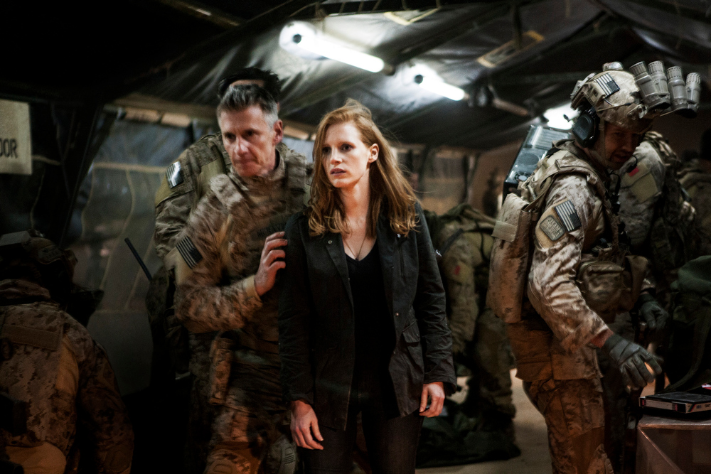 Description of . In this undated publicity photo released by Columbia Pictures Industries, Inc., Jessica Chastain, center, plays a member of the elite team of spies and military operatives, stationed in a covert base overseas, with Christopher Stanley, left, and Alex Corbet Burcher, right, who secretly devote themselves to finding Osama Bin Laden in Columbia Pictures' new thriller,