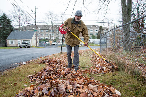 11/20/19 Wesley Bunnell | StaffrrRaul Gonzalez rakes up the last of the leaves around his property on Wednesday afternoon November 20, 2019.