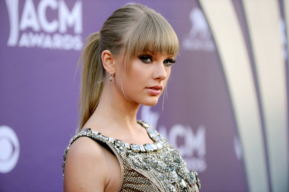 . Singer Taylor Swift arrives at the 48th Annual Academy of Country Music Awards at the MGM Grand Garden Arena in Las Vegas on Sunday, April 7, 2013. (Photo by Al Powers/Invision/AP)