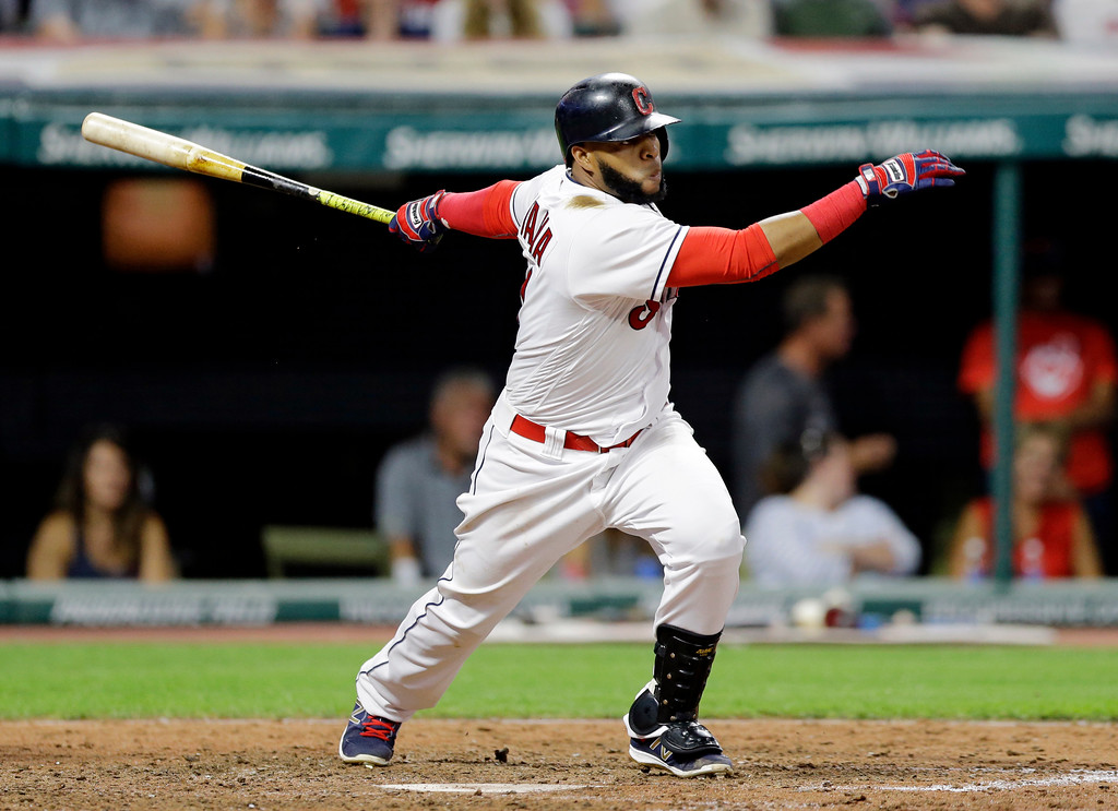 . Cleveland Indians\' Carlos Santana hits an RBI-single off Toronto Blue Jays relief pitcher Jeff Beliveau in the seventh inning of a baseball game, Friday, July 21, 2017, in Cleveland. Carlos Santana scored on the play. (AP Photo/Tony Dejak)