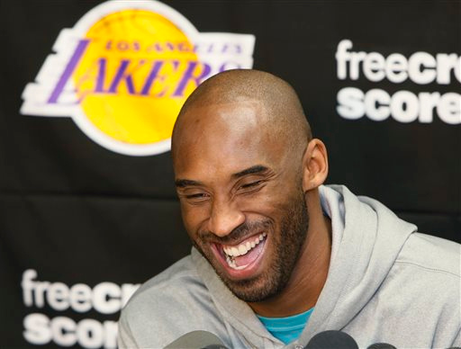 . Los Angeles Lakers guard Kobe Bryan laughs as he talks to reporters during a news conference in El Segundo, Calif., Tuesday, April 30, 2013. The Lakes lost their first-round NBA basketball playoff series to the San Antonio Spurs. (AP Photo/Damian Dovarganes)