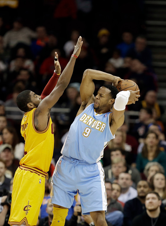 . Cleveland Cavaliers\' Kyrie Irving defends Denver Nuggets\' Andre Iguodala (9) in an NBA basketball game Saturday, Feb. 9, 2013, in Cleveland. (AP Photo/Mark Duncan)