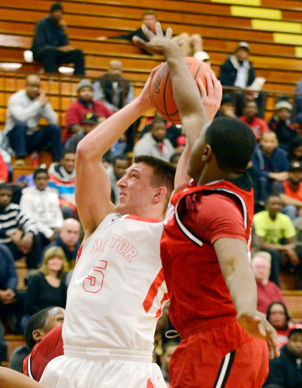 . Maribeth Joeright/MJoeright@News-Herald.com Glenville\'s Terrell Goss blocks a shot by Mentor\'s Conner Krizancic in the fourth quarter of the Division I district semifinal game, March 6, 2014.