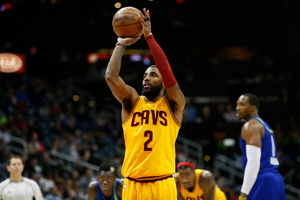 . Cleveland Cavaliers guard Kyrie Irving (2) shoots a free throw against the Atlanta Hawks in the second half of an NBA basketball game, Friday, March 3, 2017, in Atlanta. The Cavaliers won 135-130. (AP Photo/Brett Davis)