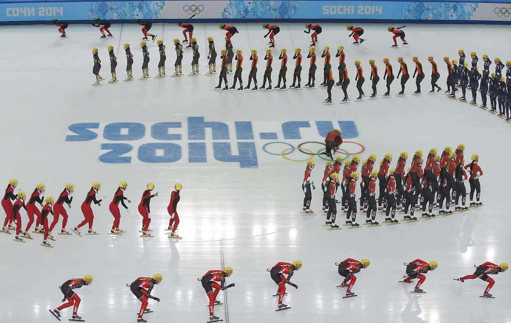 . Short track skaters warm up before the Women\'s Short Track 3000 m Relay Semifinals at the Iceberg Skating Palace during the Sochi Winter Olympics on February 10, 2014. AFP PHOTO / ADRIAN DENNISADRIAN DENNIS/AFP/Getty Images