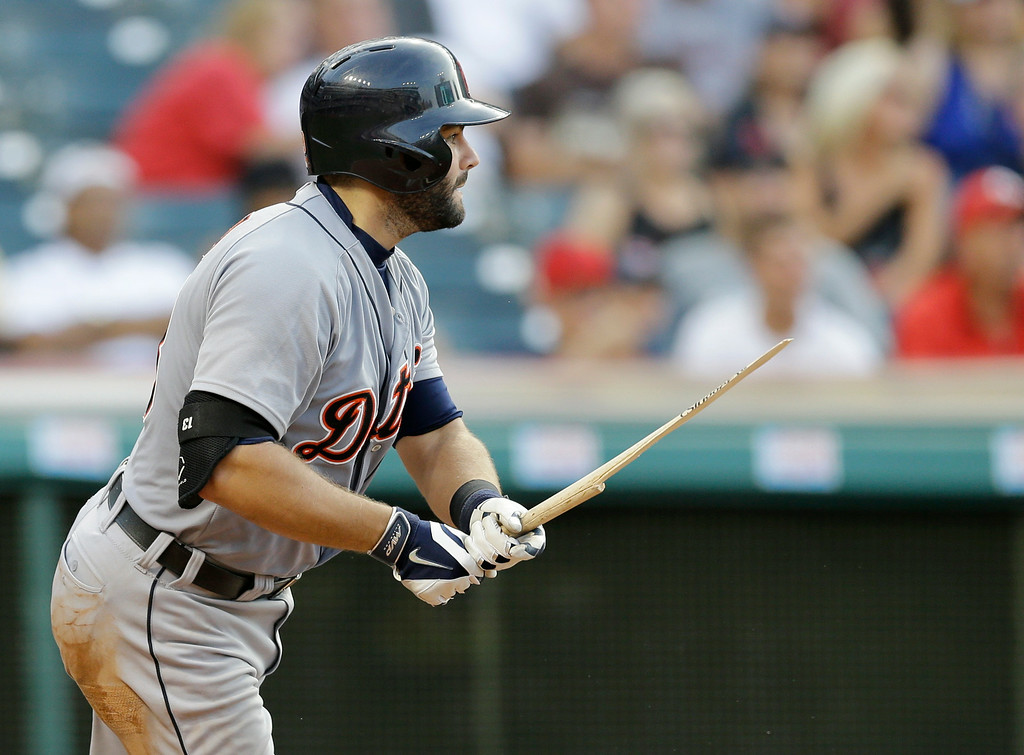 . Detroit Tigers\' Alex Avila breaks his bat and hits an RBI-single off Cleveland Indians relief pitcher Bryan Price in the eighth inning of a baseball game, Monday, Sept. 1, 2014, in Cleveland. Don Kelly scored on the play. (AP Photo/Tony Dejak)
