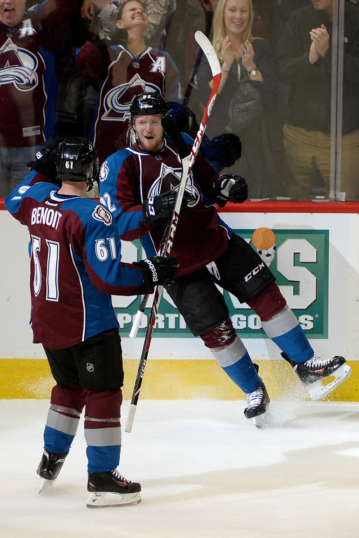 . Gabriel Landeskog (92) of the Colorado Avalanche celebrates his 3-1 goal against the Minnesota Wild with teammate Andre Benoit (61) during the second period. The Colorado Avalanche hosted the Minnesota Wild in the first round of the Stanley Cup Playoffs at the Pepsi Center on Saturday, April 19, 2014. (Photo by AAron Ontiveroz/The Denver Post)