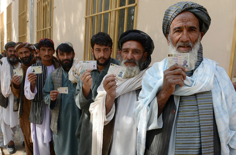 . Afghan voters display their national identity cards as they queue to cast their votes at a local polling station in Kandahar on April 5, 2014. Afghan voters went to the polls to choose a successor to President Hamid Karzai, braving Taliban threats in a landmark election held as US-led forces wind down their long intervention in the country. (BANARAS KHAN/AFP/Getty Images)