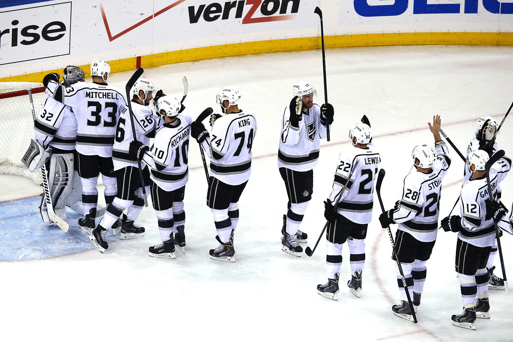 . The Los Angeles Kings celebrate their 3-0 victory over the New York Rangers in Game Three of the 2014 NHL Stanley Cup Final at Madison Square Garden on June 9, 2014 in New York, New York.  (Photo by Al Bello/Getty Images)