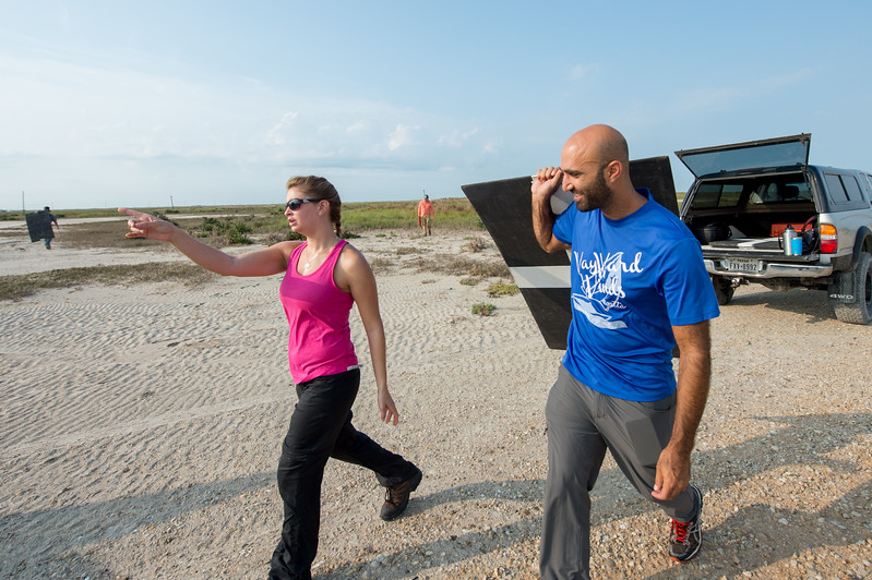 TAMU-CC research scientist Melanie Gingrass (left) and student researcher Yeoshua Cohen; set out to place markers during their survey of Mustang Island.