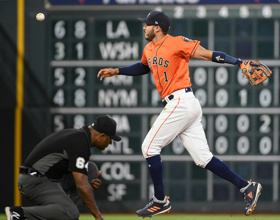 . Houston Astros shortstop Carlos Correa misplays a ground ball hit by Cleveland Indians\' Jose Ramirez during the seventh inning of a baseball game Friday, May 18, 2018, in Houston. The play was ruled a hit. (AP Photo/Eric Christian Smith)