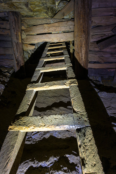 Old wooden ladder in the mine
