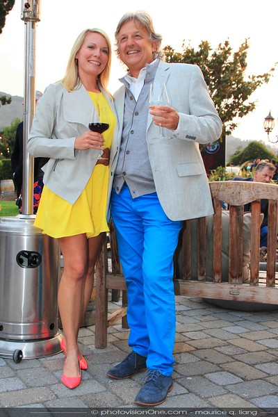 Tamara's bright pink Kate Spade shoes and yellow dress contrast with friend's bright blue pants.