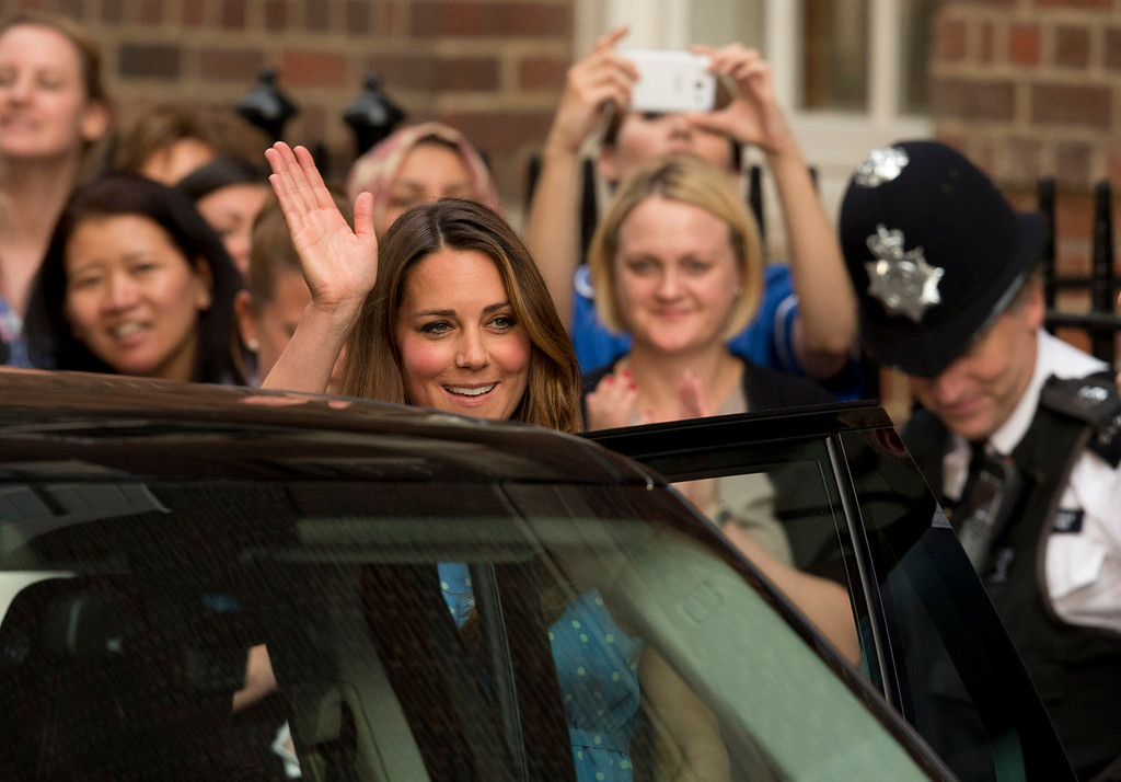 . Britain\'s Kate Duchess of Cambridge waves as she gets in a vehicle to leave, Tuesday July 23, 2013, after posing with her husband Prince William and their newly born baby son for photographers outside St. Mary\'s Hospital exclusive Lindo Wing in London where the Duchess gave birth on Monday July 22. The Royal couple are expected to head to Londonís Kensington Palace from the hospital with their newly born son, the third in line to the British throne.  (AP Photo/Matt Dunham)