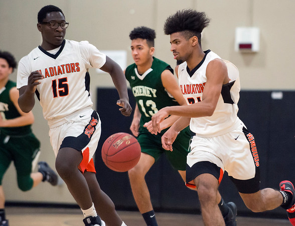 02/07/20 Wesley Bunnell | Staff Goodwin Tech boys basketball defeated Cheney Tech at home on Friday February 7, 2020.Luis Aguiiar (24) dribbles downcourt next to teammate Terrence French (15).