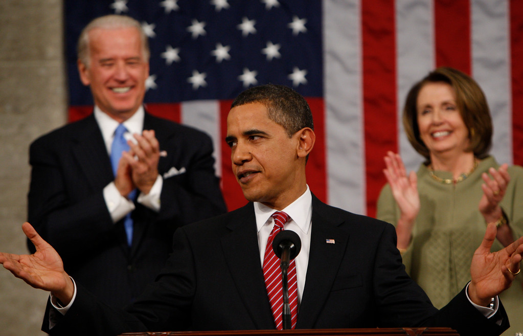 . President Barack Obama acknowledges applause before his address to a joint session of Congress in the House Chamber of the Capitol in Washington, Tuesday, Feb. 24, 2009. Vice President Biden and House Speaker Nancy Pelosi applaud at rear.  (AP Photo/Pablo Martinez Monsivais, Pool)