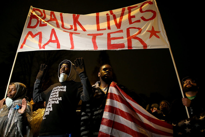 . Demonstrators march through the streets while protesting the shooting death of 18-year-old Michael Brown on November 23, 2014 in St. Louis, Missouri. Tensions in Ferguson remain high as a grand jury is expected to decide this month if Ferguson police officer Darren Wilson should be charged in the shooting death of Michael Brown.  (Photo by Justin Sullivan/Getty Images)