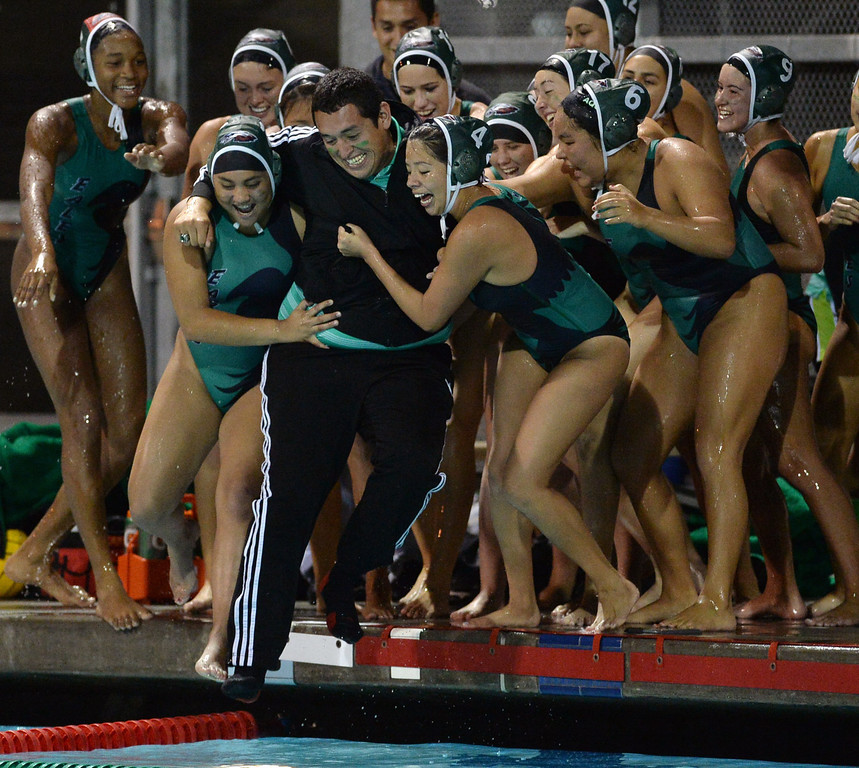 . Eagle Rock High School coach Andres Gonzalez is thrown in to the pool by players after beating Palisades to win the City Section girls water polo final at the Contreras Learning Complex in Los Angeles Thursday, February 27, 2014. (Photo by Hans Gutknecht/Los Angeles Daily News)