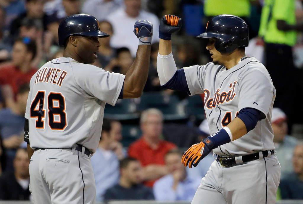 . Detroit Tigers\' Victor Martinez, right, celebrates with teammate Tori Hunter after hitting a solo home against the Chicago White Sox during the fifth inning of a baseball game in Chicago, Thursday, June 12, 2014. (AP Photo/Nam Y. Huh)