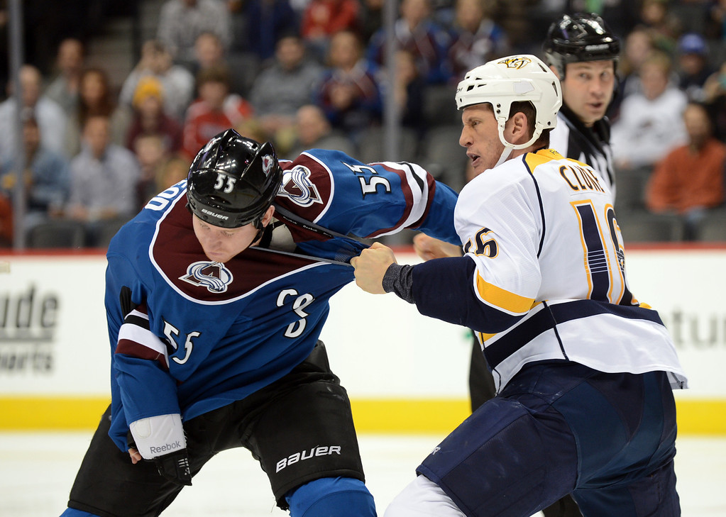 . Cody McLeod of Colorado Avalanche (#55), left, and Rich Clune of Nashville Predators (#16) are fighting in the 1st period of the game at Pepsi Center. Denver, Colorado. March 30, 2013. (Photo By Hyoung Chang/The Denver Post)