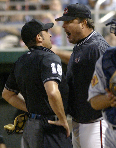 Chico Outlaws Manager Mark Parent (right)  yells at homeplate umpire Billy Haze (left) during the Chico Outlaw vs. Reno Silver Sox baseball game in the bottom of the third inning at Nettleton Stadium Friday night. Outlaws #7 Jason Van Meetren, was at bat when he stepped off the bag for time out, yet Haze didn't acknowledge thus calling a strike on Van Meetren. Then Parent came out to argue and was thrown out of the game.- halley photo 8/25/06