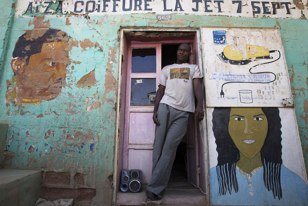 . A hair dresser stands outside his shop in Gao on April 13, 2013.  JOEL SAGET/AFP/Getty Images