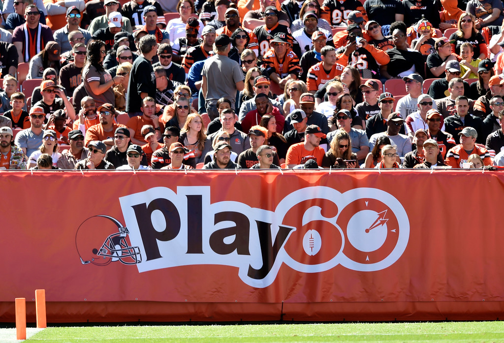 . Fans watch the Cleveland Browns play the Cincinnati Bengals in the first half of an NFL football game, Sunday, Oct. 1, 2017, in Cleveland. (AP Photo/David Richard)